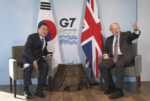 President Moon Jae-in (left) with Boris Johnson this morning at the G7.