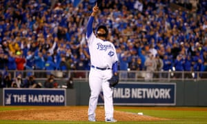 Johnny Cueto celebrates his team's 7-1 win.