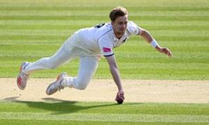 Craig Miles dives to catch Lancashire's Alex Davies off his own bowling.
