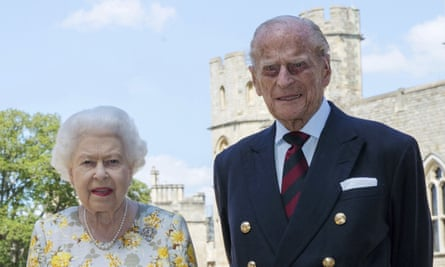 The Queen and Prince Philip, the Duke of Edinburgh, pose for a photo in the quadrangle of Windsor Castle ahead of his 99th birthday.