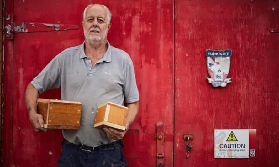 Groundsman Mal Ibbetson with the small caskets he has made for the ashes that have been excavated from under the pitch.