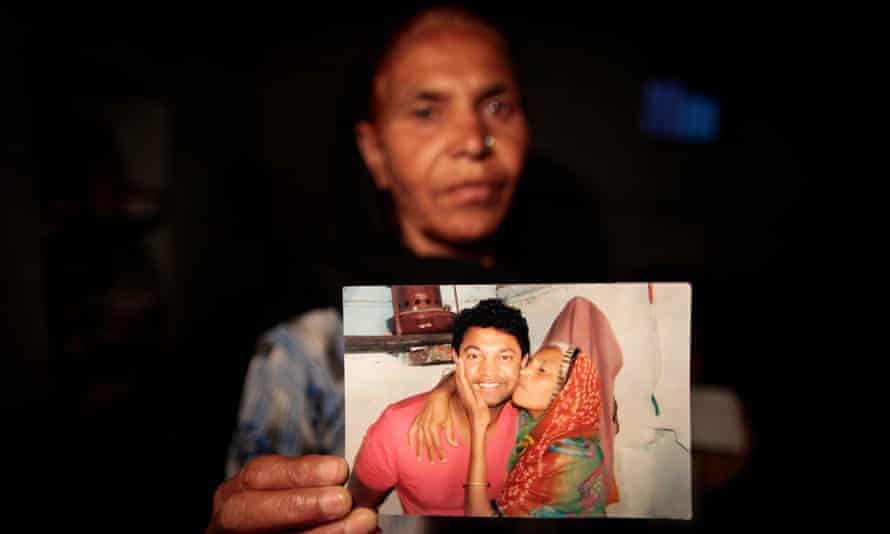 Fatima Munshi holds a photo of the moment she was reunited with her son, Saroo, after 25 years apart.