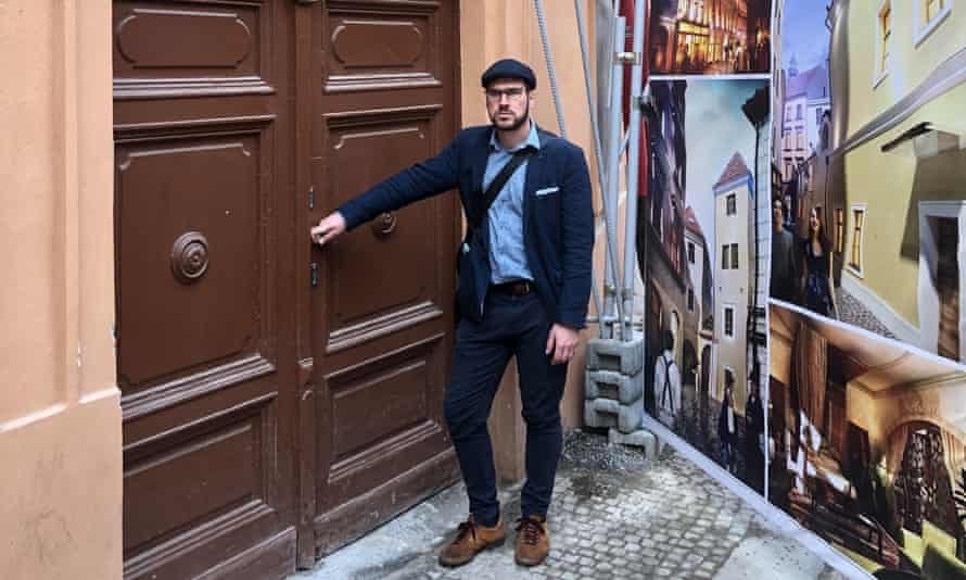 Vít Masare, the co-chair of the Green party in Prague, outside Schmolka's former home.