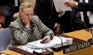The then secretary of state, Hillary Clinton, checks her mobile phone after her address to the security council at United Nations headquarters in March 2012.