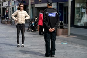 Leicester, England A police officer talks to a shopper maintaining physical distancing before non-essential shops close for the localised pandemic lockdown