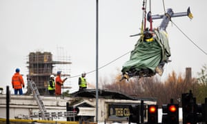The wreckage of the police helicopter is removed from the Clutha pub in Glasgow.