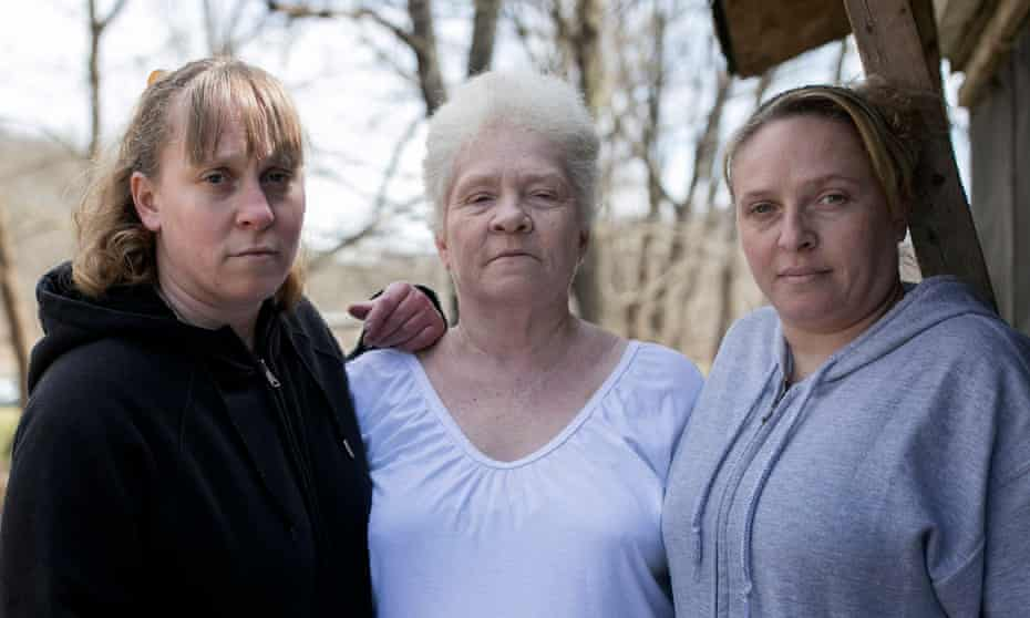 Roberta Oiler, center, stands with her daughters Janelle Stanley and Jessica Keaton in East Jackson, Ohio.