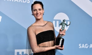 Phoebe Waller-Bridge reveals her painted-on abs at the Screen Actors Guild awards.