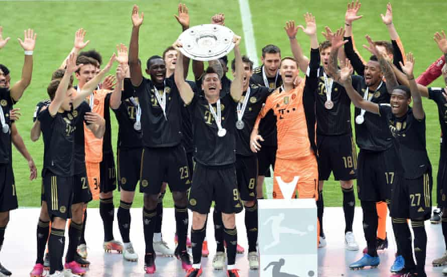 robert lewandowski celebrates with the bundesliga trophy.
