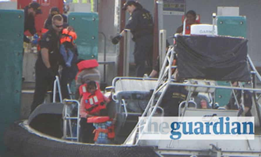 Australian customs vessel lands 157 Tamil asylum seekers on the Cocos Islands in July 2014