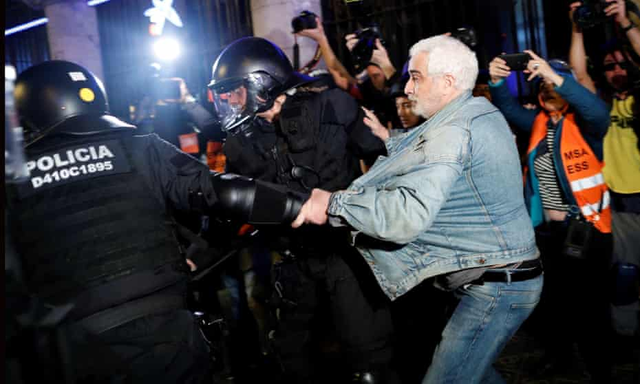 Police drag a man during a Catalan independence demonstration in Barcelona on Saturday night.