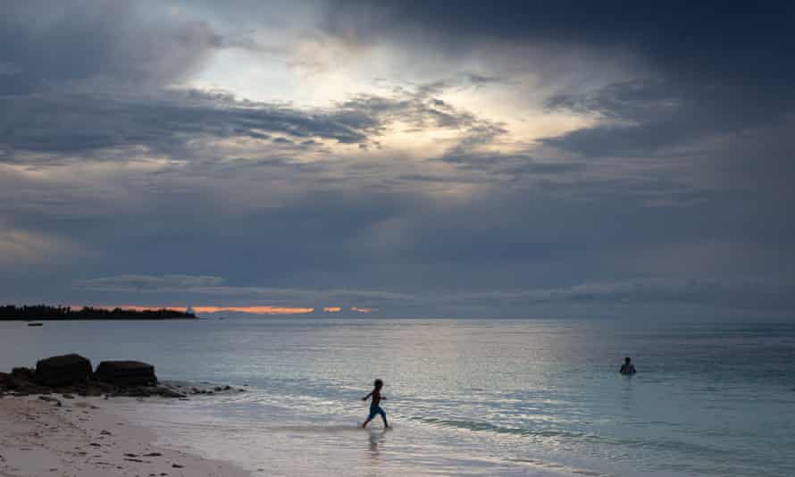 A young boy plays in the shallows of the Funafuti lagoon, Tuvalu