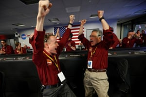 Pasadena, California, USNASA engineers Kris Bruvold (L) and Sandy Krasner react in the space flight operation facility at NASA's Jet Propulsion Laboratory (JPL) as the spaceship InSight lands on the surface of Mars after a six-month journey