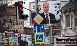 Campaign billboards for president Putin are displayed in Simferopol