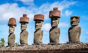 Moai at Anakena beach under sunny summer sky, Rapa Nui, Chile.