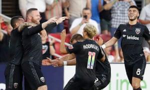 Wayne Rooney celebrates his goal with his DC United teammates
