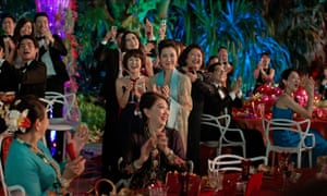 Showstopping performance … Michelle Yeoh, standing centre, in Crazy Rich Asians.