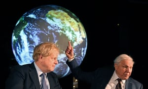 BRITAIN-UN-CLIMATE-SUMMIT<br>Britain's Prime Minister Boris Johnson (L) sits with British broadcaster and conservationist David Attenborough, during an event to launch the United Nations' Climate Change conference, COP26, in central London on February 4, 2020. - Britain will bring forward a ban on sales of new petrol and diesel vehicles to 2035, including hybrids, Prime Minister Boris Johnson was to announce on Tuesday. Johnson was to make the announcement at an event launching the 2019 United Nations Climate Change conference, COP26, which will be held in Glasgow in November. (Photo by Jeremy Selwyn / POOL / AFP) (Photo by JEREMY SELWYN/POOL/AFP via Getty Images)