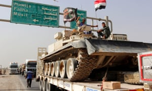 A convoy of Iraqi security forces advances on the outskirts of Mosul