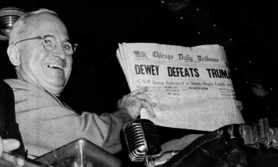 Harry Truman holding up a copy of the  Chicago Daily Tribune wrongly proclaiming his defeat to Thomas Dewey