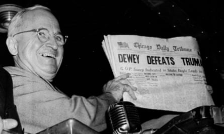 "US president Harry S. Truman holds up an election day edition of the Chicago Daily Tribune that, based on early results, mistakenly announced ""Dewey Defeats Truman"" in 1948."