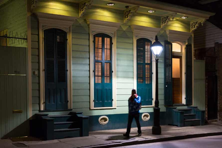 A walks in residential neighborhood on Bourbon Street in French Quarter of New Orleans.