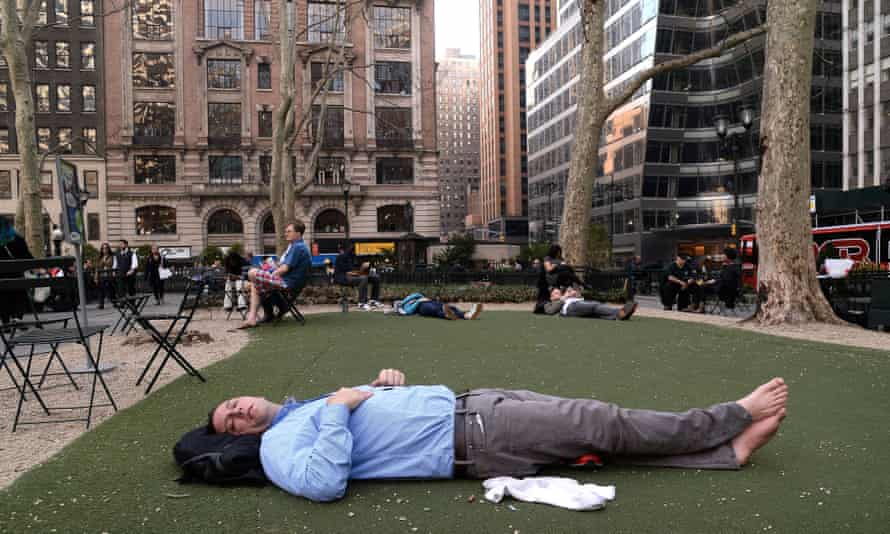 A man takes a nap as New York experiences record temperatures in March. 'We appear uninterested in the environmental changes happening right in front of our eyes,' says James Dyke.
