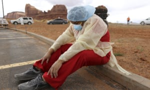 A Navajo health worker takes a brief break as vehicles line up for Covid-19 testing outside of the Monument Valley health center in Utah last month.