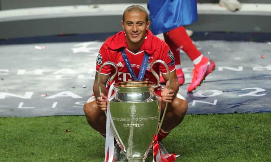 Thiago Alcântara with the Champions League trophy