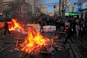 Demonstrators lighting bonfires in Valparaíso