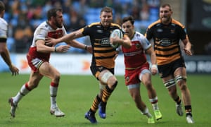 Wasps' Thomas Young evades a tackle from Northampton's Tom Wood at the Ricoh Arena as the home side posted a much-needed Premiership win.