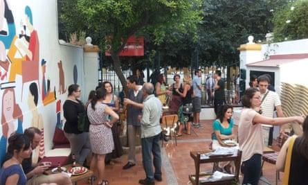 El Viajero Sedentario cafe/meeting place with its courtyard and orange tree.