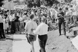 Moree mayor William Lloyd escorts protesters away from the pool