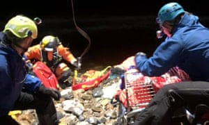 Lochaber mountain rescue team members work to evacuate the man.