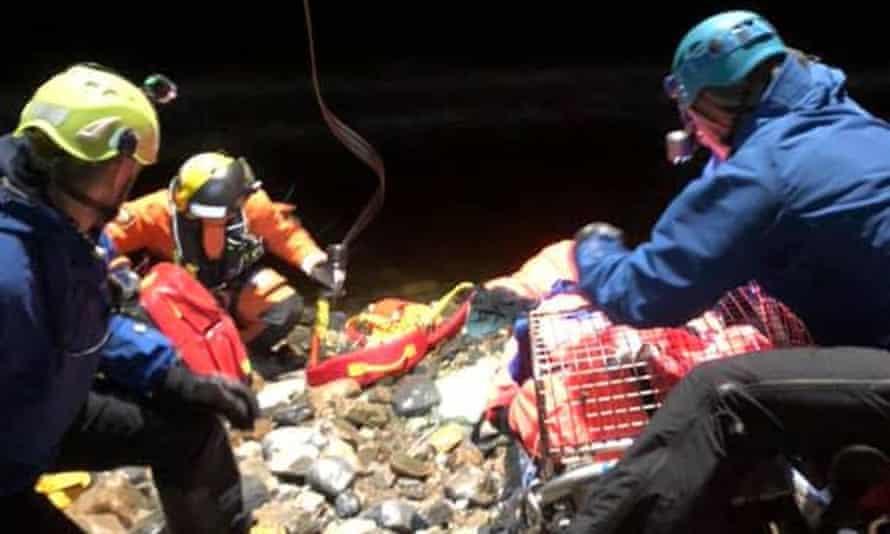 Lochaber mountain rescue team members work to evacuate the man.