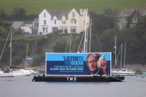A protest banner is displayed in Falmouth Bay