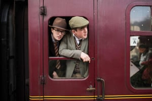 World War II reenactors look out from a train at the 25th 'Railway in Wartime Event' along the line of the heritage 'North Yorkshire Moors Railway' at Levisham Station, near Pickering, northern England