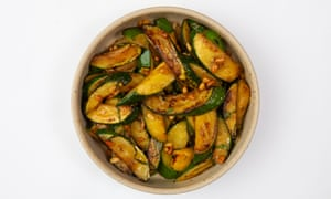 'Served with a dollop of confit garlic': fried courgettes with pine nuts.