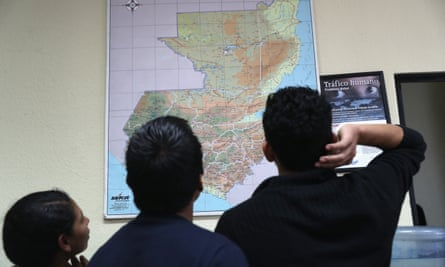 Immigrants look over a map of Guatemala after arriving on an Ice deportation flight.