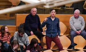 A climate crisis protester interrupting first minister's questions in Holyrood this afternoon.