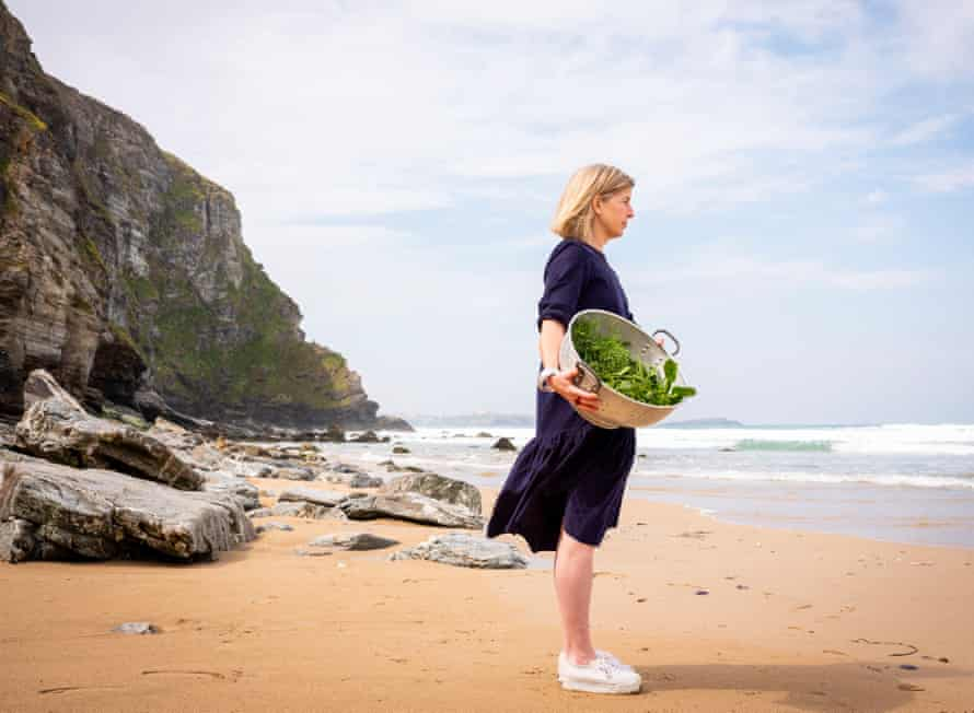 Chef Emily Scott on the beach at Watergate Bay.