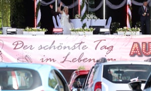 A couple marry in a socially distanced ceremony at a drive-in cinema in Germany.