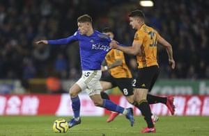 Leicester City's Harvey Barnes is held back by Leander Dendoncker.
