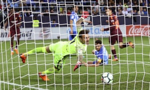 Philippe Coutinho scores Barcelona's second goal against Málaga.