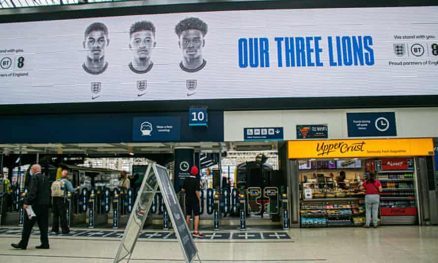 A poster of England football players Marcus Rashford, Jadon Sancho and Bukayo Saka – all of whom received racial abuse after the final - at Waterloo station.