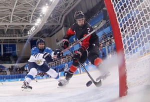 Canada's Meghan Agosta scores a goal in the first period against Finland during the women's ice hockey preliminary round, group A game at the Kwandong Hockey Centre.