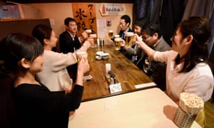 Employees of Japanese company Suntory drink at a pub after finishing work at 3pm in Tokyo