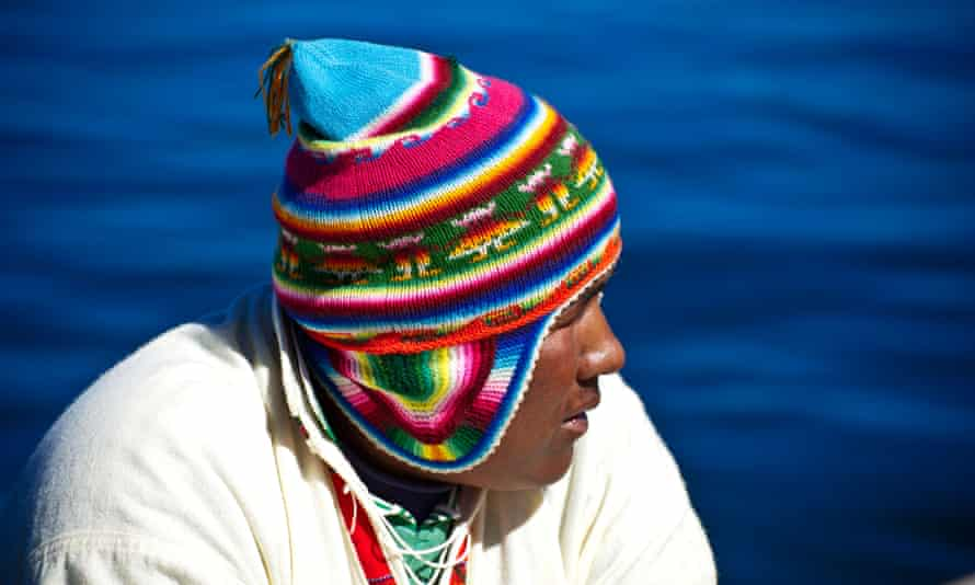 An Uros Indian living on floating islands made by reeds on Titicaca lake.