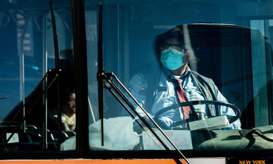 A bus driver wearing a face mask in New York City on 17 April 2020.