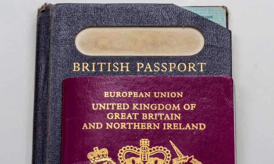Old-style British passport with EU British passport on top